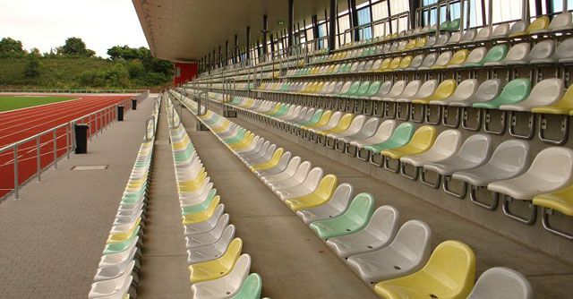 Tribune seating chair for sport halls or stadiums